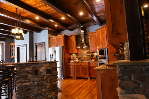 Log home kitchen with stone accents.