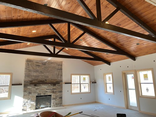 King post interior trusses stained dark walnut.