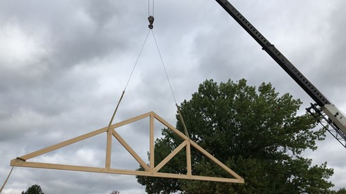 Queen post truss installation.