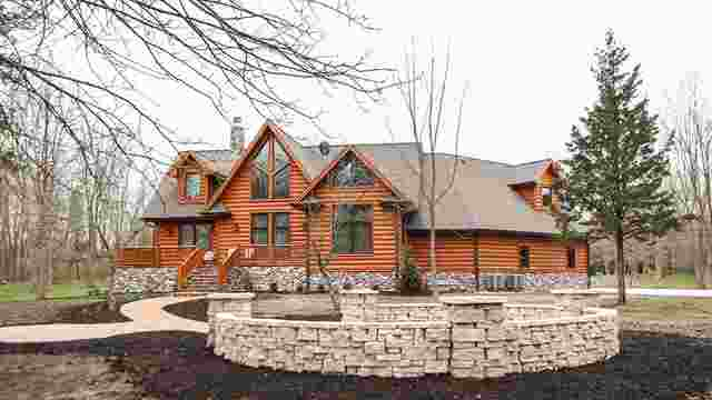 House with 3X10 Cedar Hand Hewn Log Siding