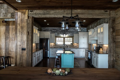 Front view of lake house kitchen with circle-sawn barn wood siding.