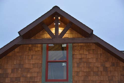 King post truss with cedar shake panels.