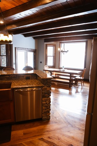 Log home kitchen with picnic dining table.