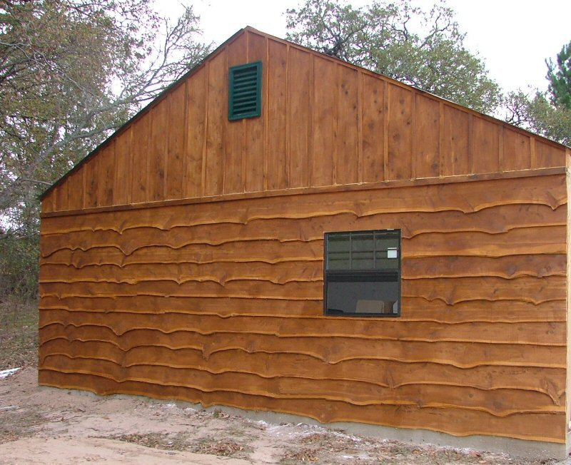 Wavy edge bevel siding with board and batten roofing.
