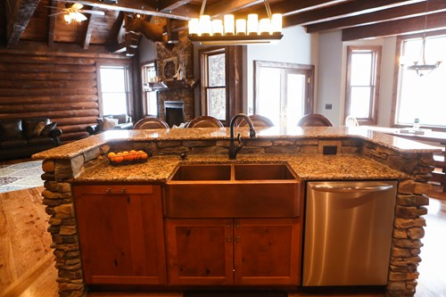 Kitchen island with farmhouse sink and granite countertops.