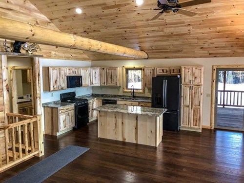 Open concept kitchen in log home.