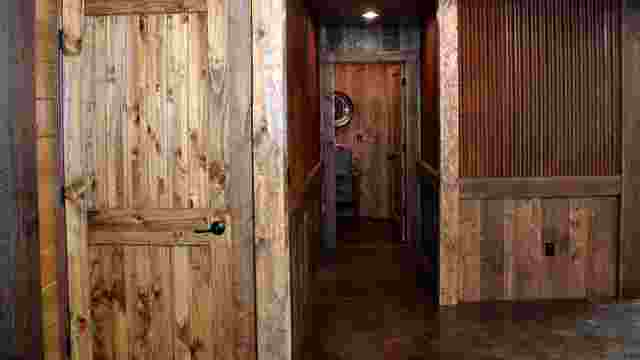 Barnwood Paneled Interior with Knotty Doors